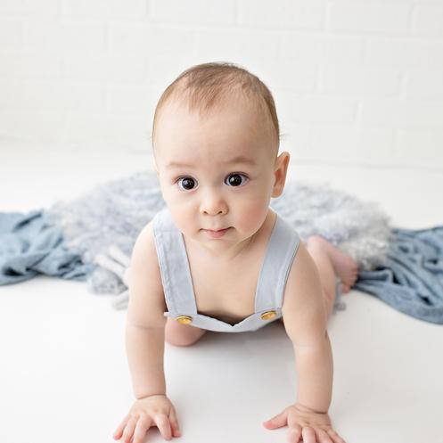Baby boy in blue crawling