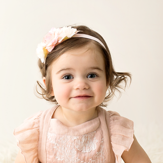Little girl turing one in pink outfit