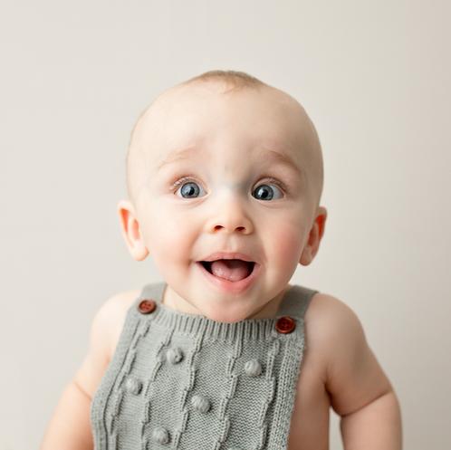 Happy little boy in simple portrait