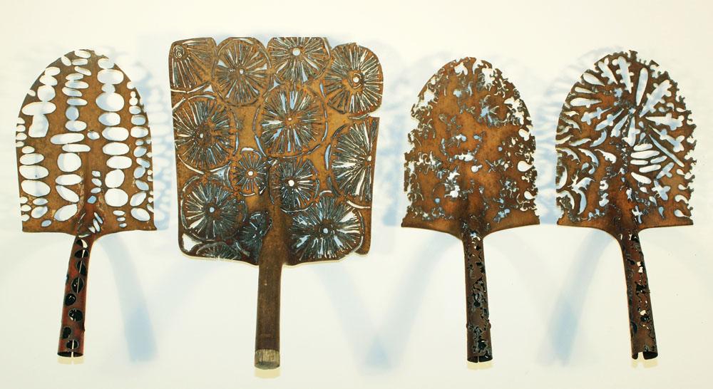 pierced metal lace shovel sculpture