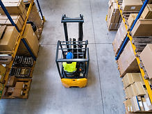 Warehouse man worker with forklift..jpg
