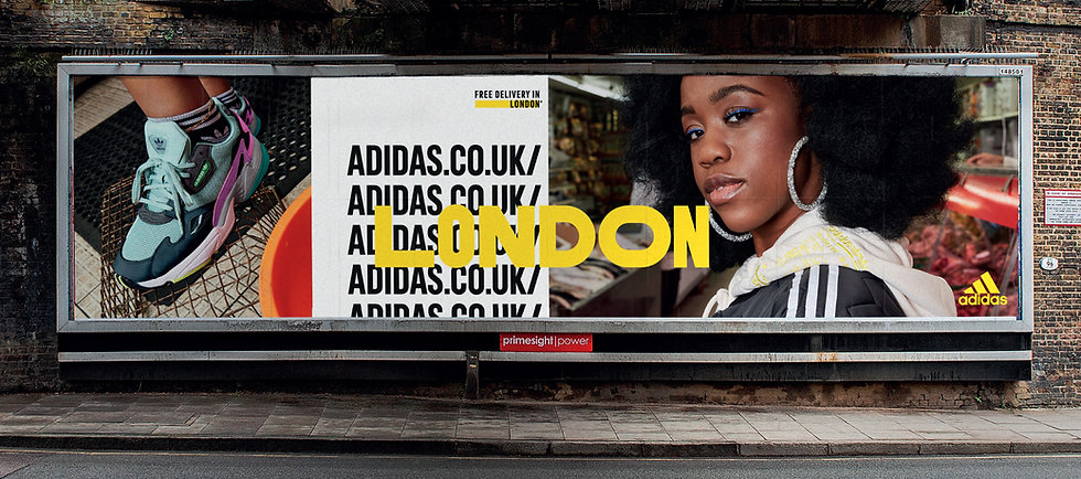 Outdoor advertising of model wearing adidas trainers and tracksuit