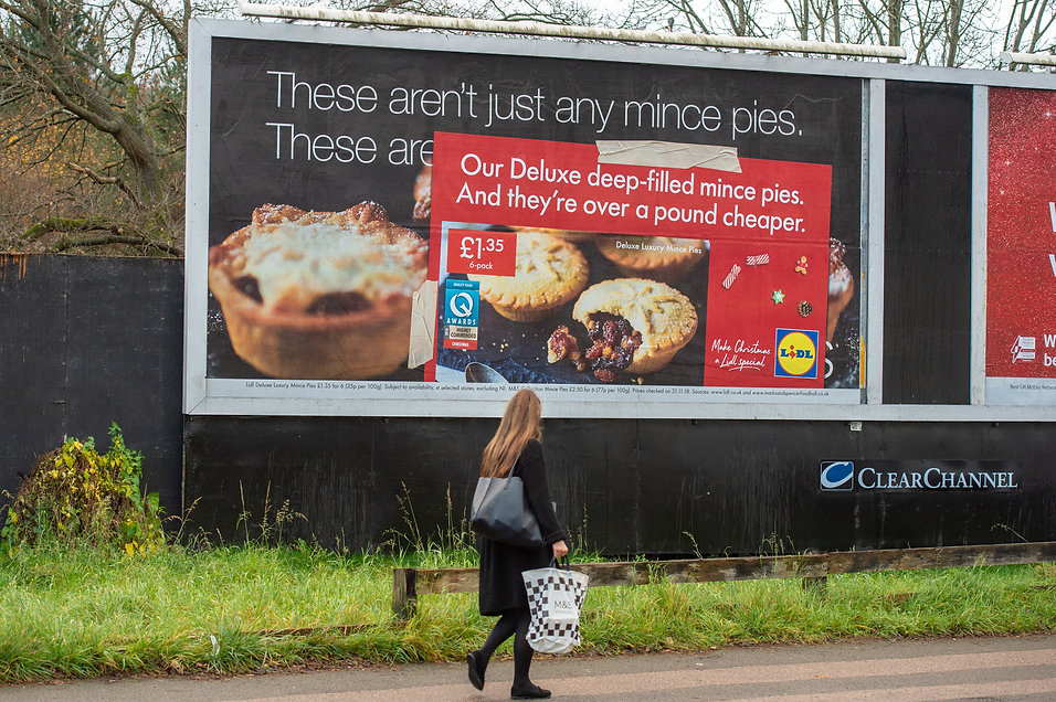 OOH advertising of Lidl mince pies, on top of rival supermarket M&S