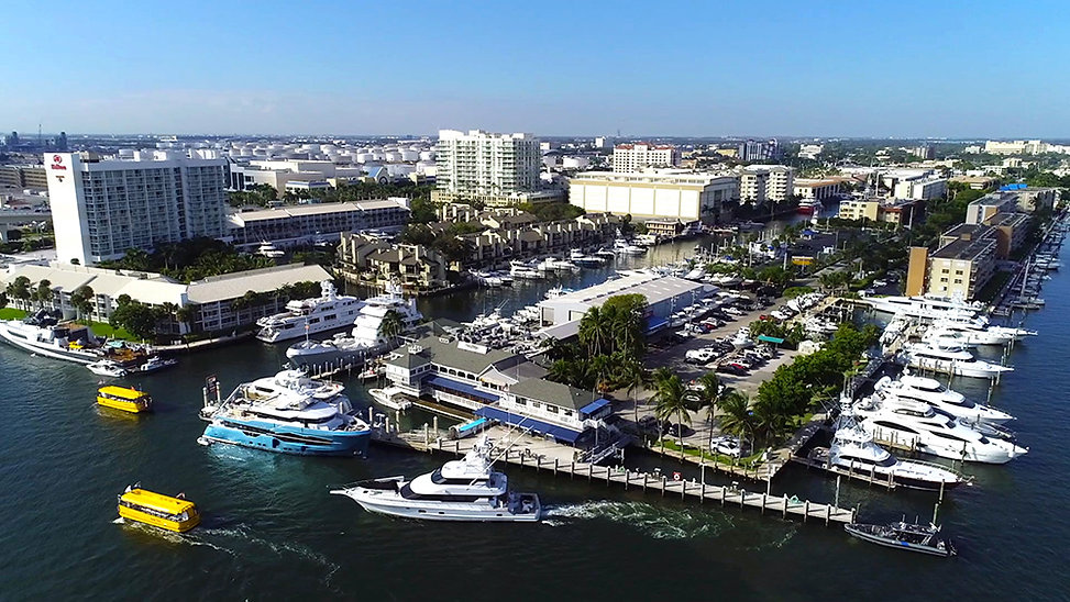 This is an aerial drone view of Lauderdale Marina with 15th Street Fisheries located beside the dock.