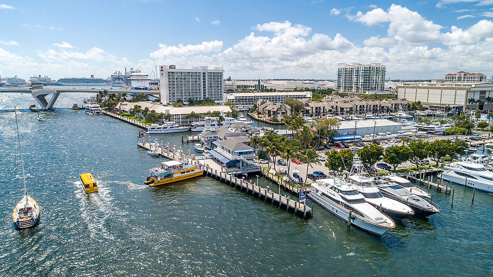 Aerial View of Lauderdale Marina on the Intracoastal Waterway with boats passing by