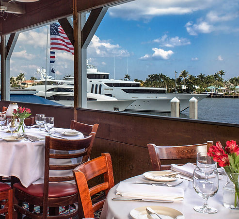 View of the Intracoastal Waterway from Fisheries upstairs dining room, dinner tables set in the foreground