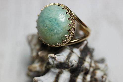 Позолоченное круглое кольцо с аквамарином