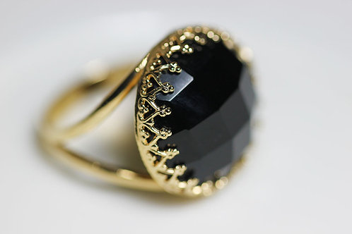 Позолоченное круглое кольцо с ониксом