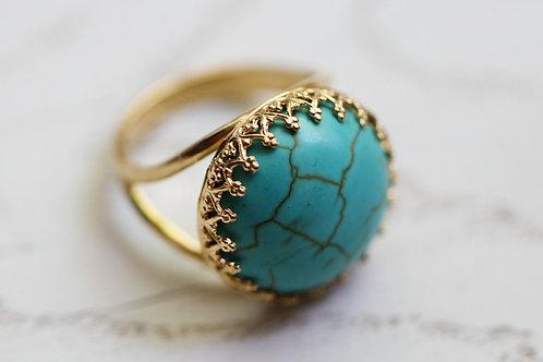 Позолоченное круглое кольцо с бирюзой