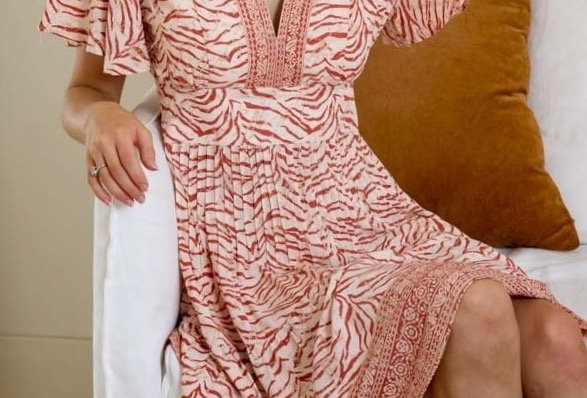 Red zebra patterned boho mini dress  V neck Short sleeve Zip at back Pleating detail