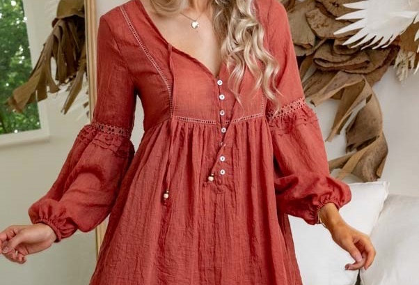 Stunning rust coloured linen look dress with button detailing V neck Shell buttons in the front Blouse like sleeve Lace inser