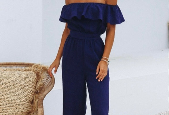 Stunning blue jumpsuit, off the shoulder making it the perfect chic jumpsuit to dress up or down!
