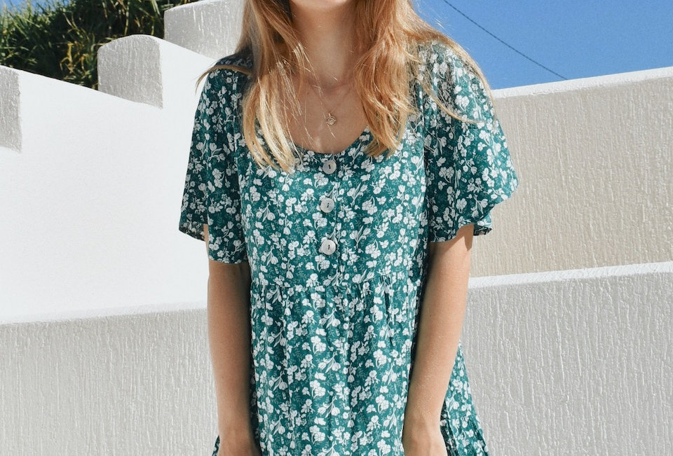 Cute forest green floral mini  Circle neckline Shell buttons Cap sleeve Forest green with white floral pattern 100% Rayon