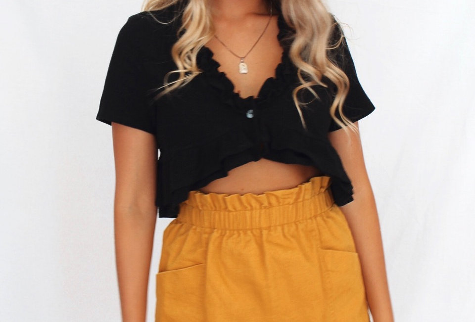Black crop top button closure at front