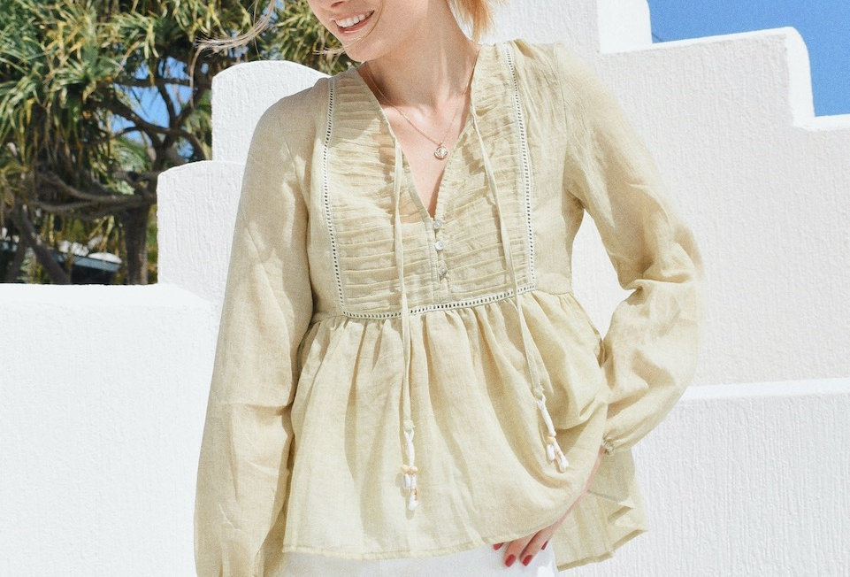 Light green linen blouse  Buttons at front Shell detail Light weight  Semi sheer