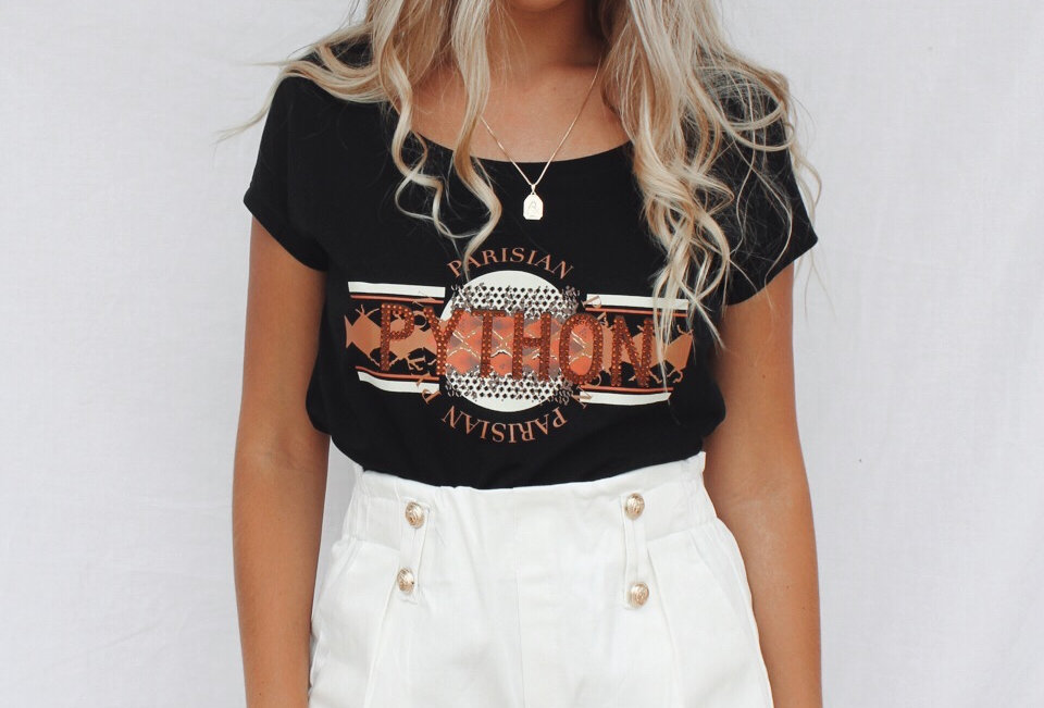 Cute white shorts with gold button detailing