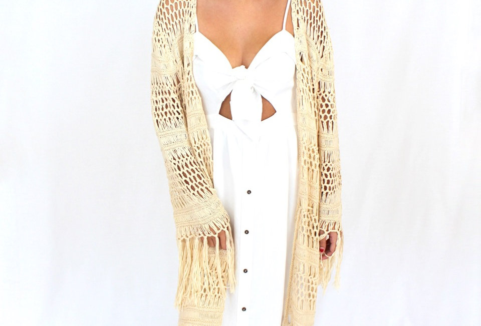 Cute loose knit cardigan in a cream, perfect for this cooler weather to match with a dress or even jeans and a top!