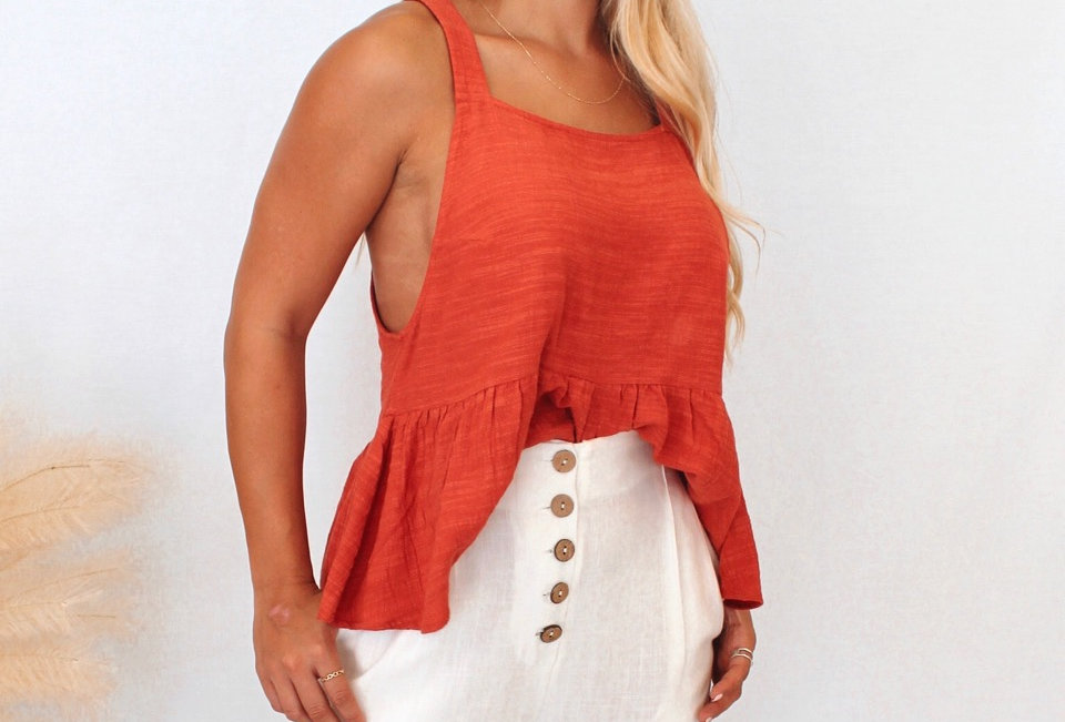 Casual loose fitting top Textured Linen and cotton look top Easy fit Decorative Shell button with loops opening detail at