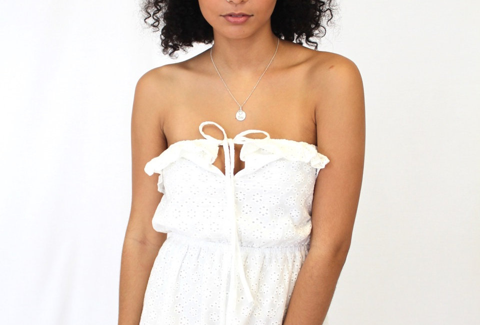Cute white lace detailed playsuit, perfect little number to dress up with your fav boots and some red lipstick!
