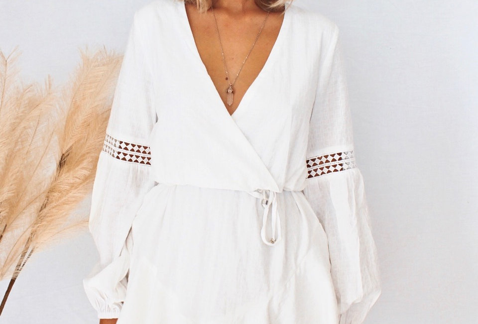 v neck white linen mini dress, blouse like sleeve with elastic at bottom, lace inserts in sleeve