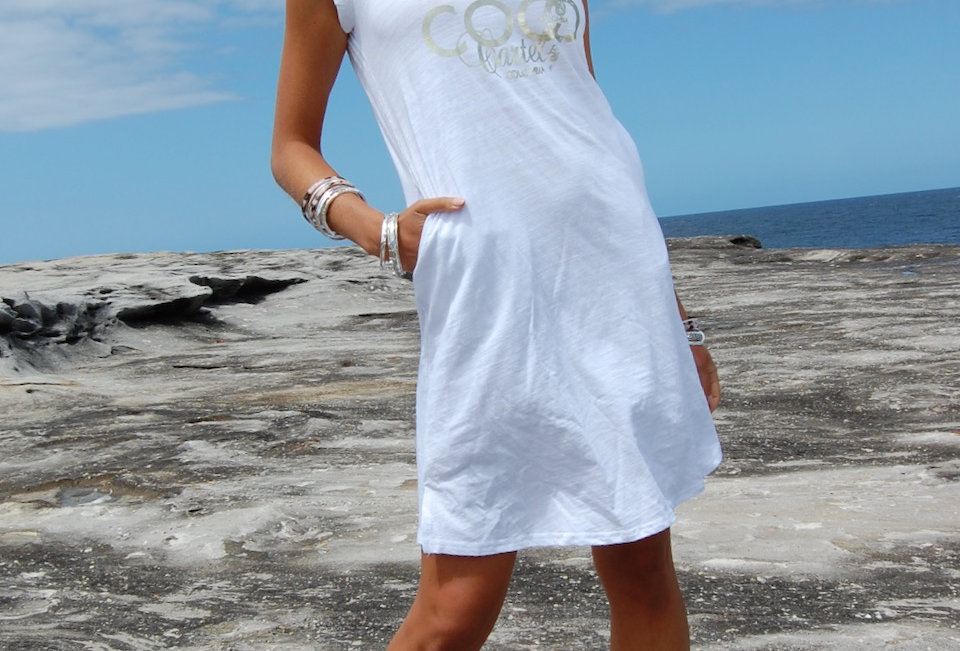 Cute tee shirt dress with coco cartel detail on front  V neck line White Tee shirt style Easy fit Cap sleeve Pockets 100% Cot