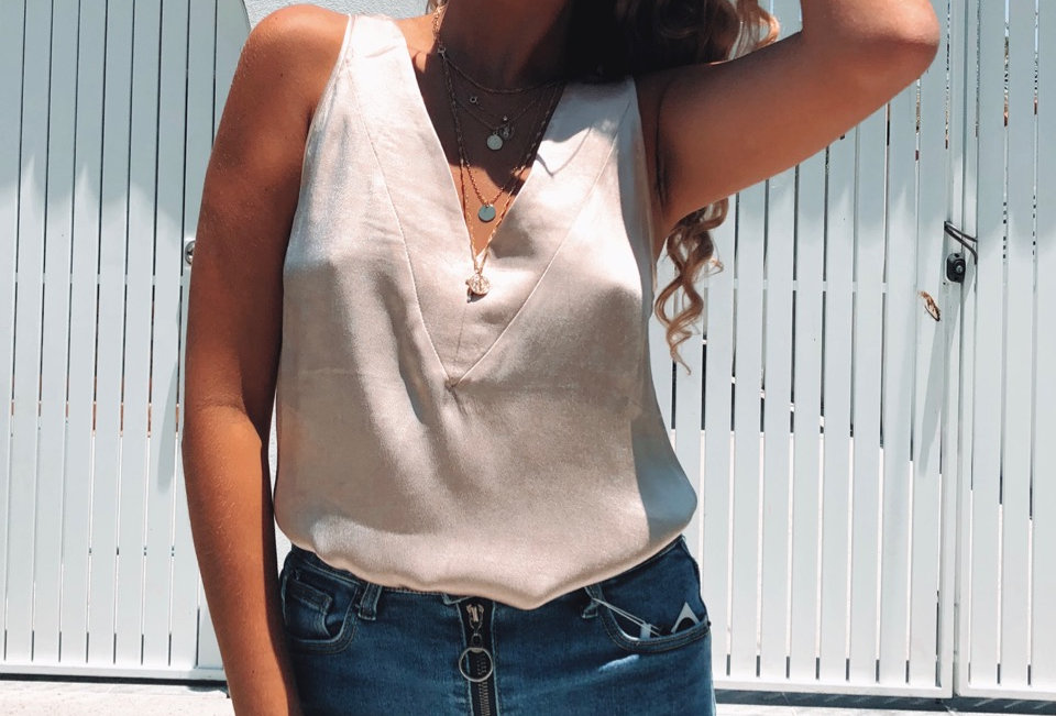 Stunning gold top, with a v neck perfect to match denim or white linen!