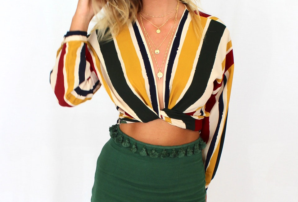 Cute multi coloured wrap top perfect with a skirt or pair of high waisted jeans for a cute look!