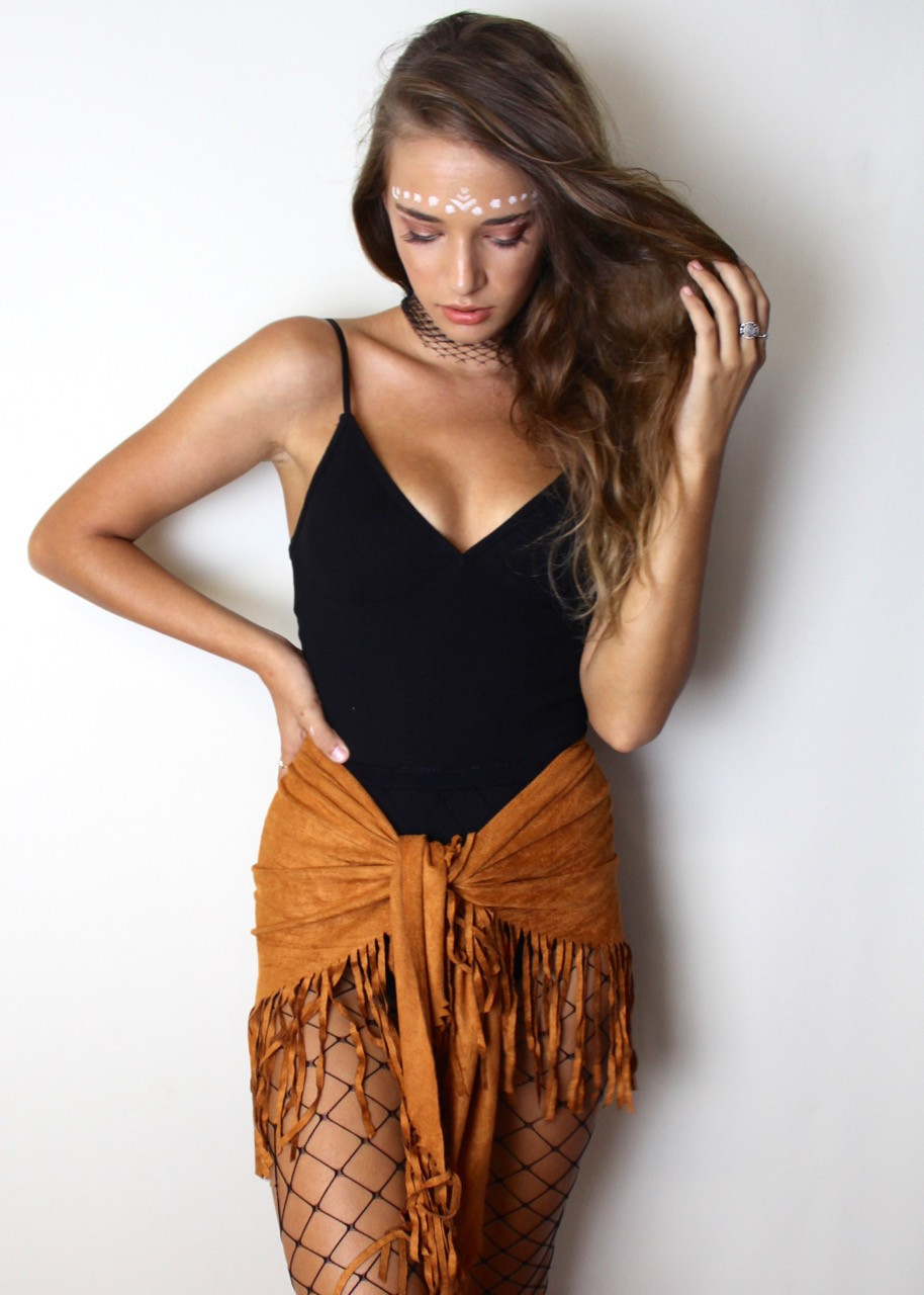 Black bodysuit with tan suede tassle skirt from Shine Boutiques, Sunshine Coast