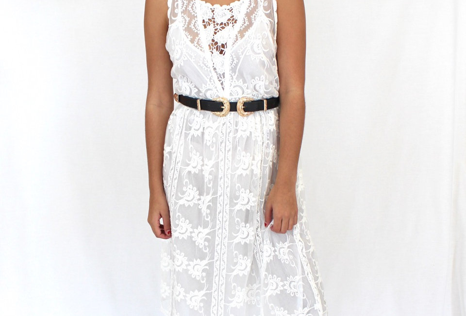 Cute white lace dress, perfect with a belt to head to a festival!