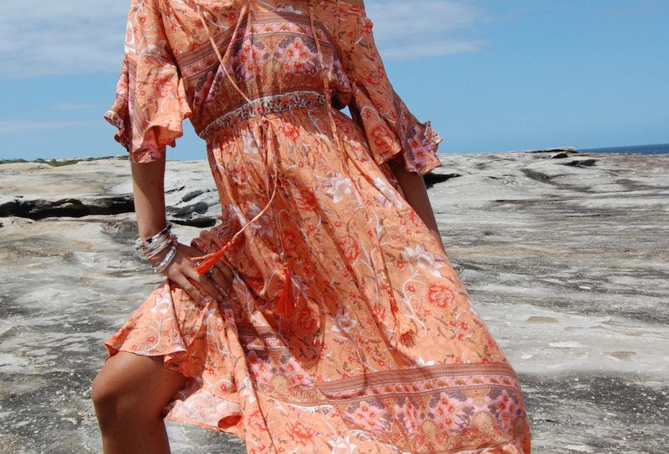Cutetangerine colouredboho patterned maxi dress  Light v neckline Cap sleeve Neckline string tie with tassel detail Elastic