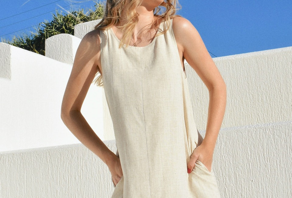Cute sand colour linen raw hem dress Circle necline Pockets Raw hem Easy fit Linned Button & loop closure at back