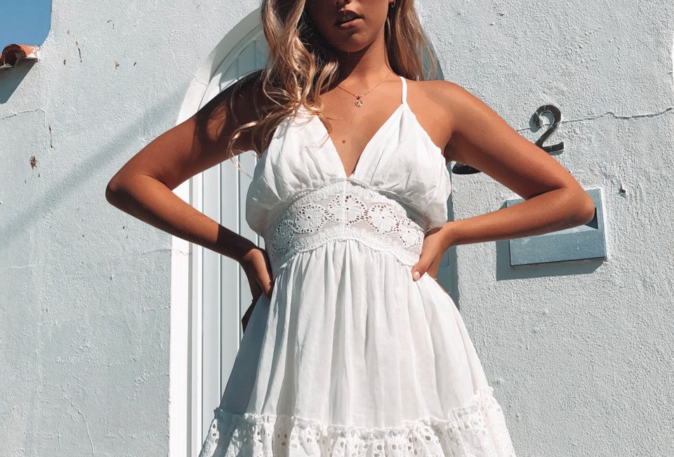 Cute white low back dress, this has perfect summer dress vibes all over it!