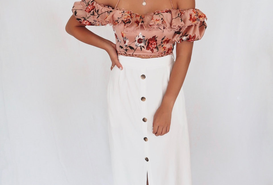 Stunning white linen midi skirt, button detail at front perfect to dress up or down!
