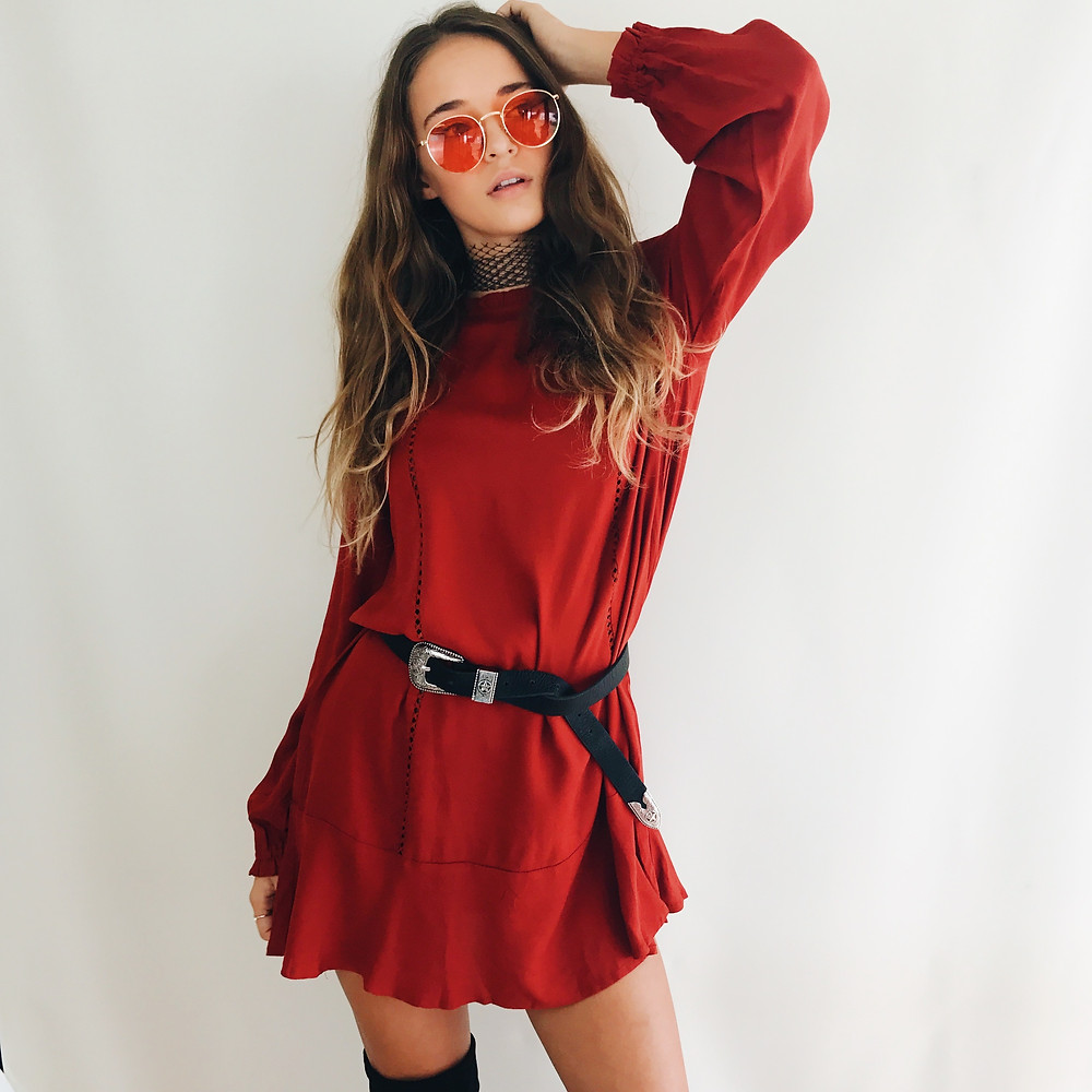 Long sleeve rusty red dress with black and silver buckled belt and black choker from Shine Boutiques Sunshine Coast Australia