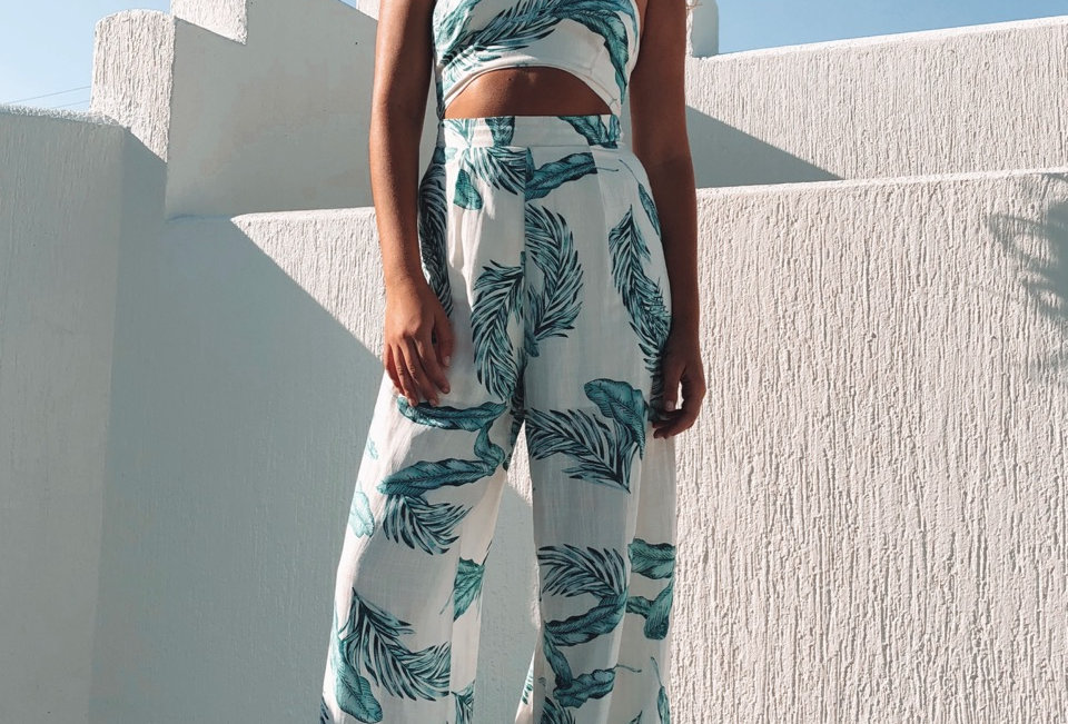 Stunning smart casual, palm tree print strapless jumpsuit!