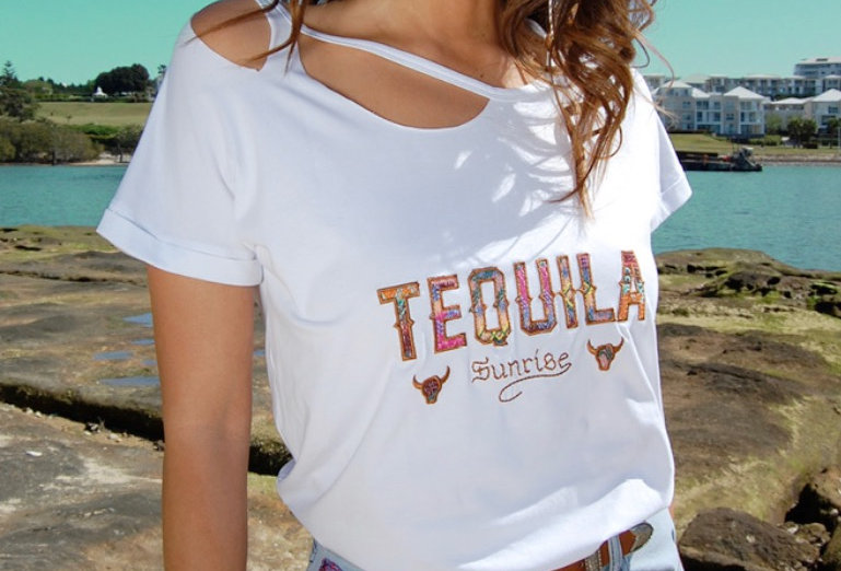 Cute Tequila graphic tee  Rip at top Vintage washed out look Circle neckline Colourful applique stitching Tequila writing