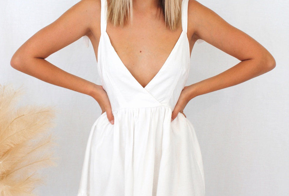 white mini dress, perfect to dress up or down White mini dress V neck Ties at shoulders Low back Zip at back Lined