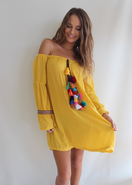 Yellow off the shoulder dress with colourful tassle pompoms from Shine Boutiques, Sunshine Coast