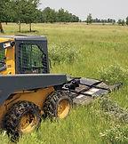 QAUBM-action-john-deere-grass.jpg