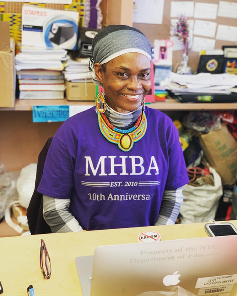 Ms. Decoteau wearing purple MHBA 10 Year Anniversary T-shirt