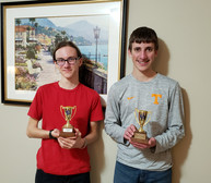 Sam and Alex with gold cups.jpg