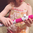Little people holding little flutes make