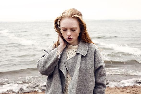 Woman standing in front of the ocean
