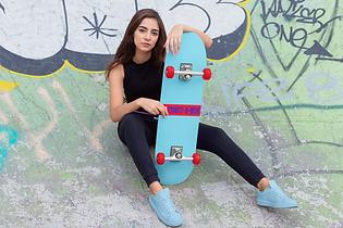 skateboard-mockup-featuring-a-woman-sitt