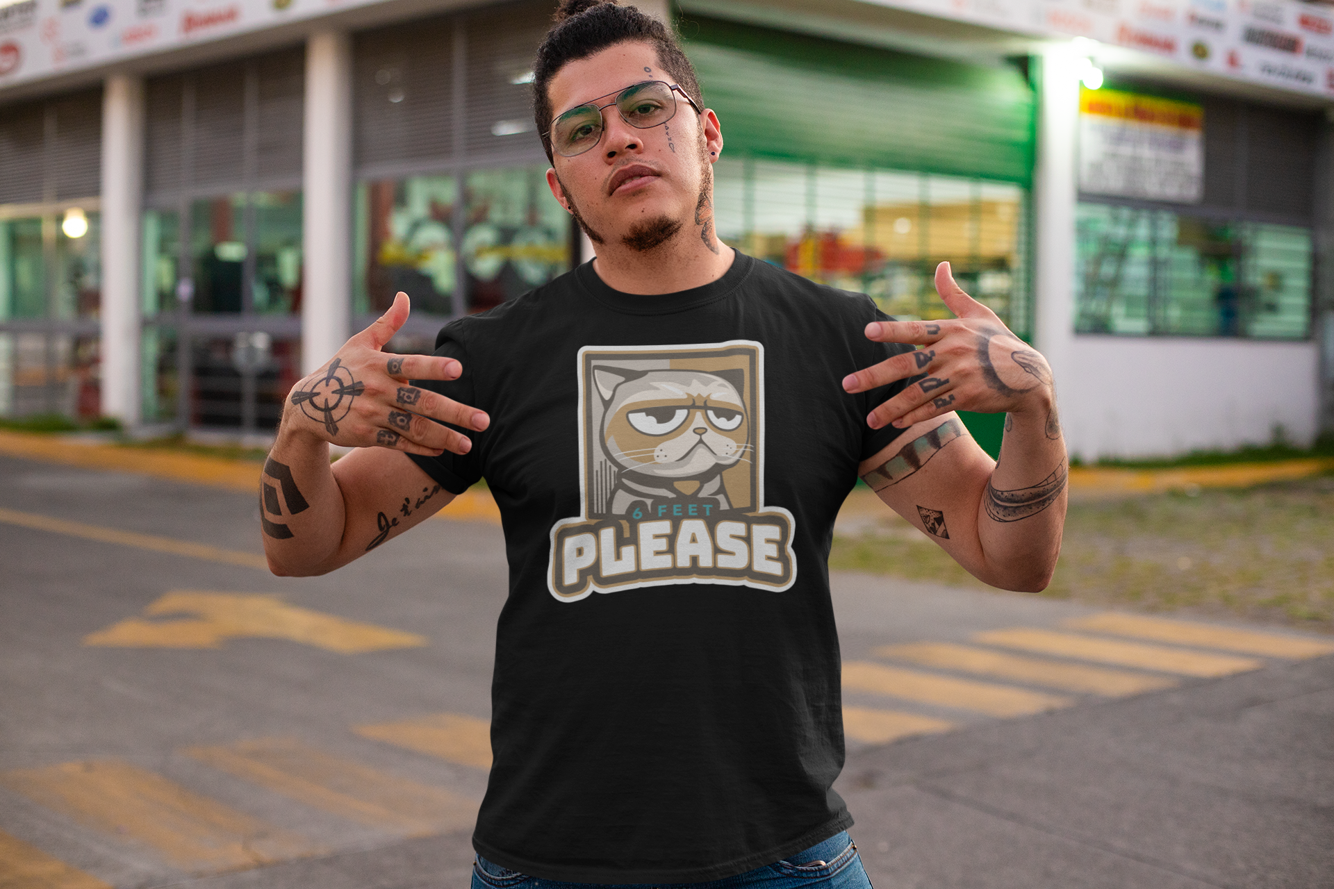 t-shirt-mockup-of-a-tattooed-man-showing