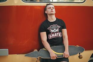 t-shirt-mockup-of-a-cool-young-man-holdi