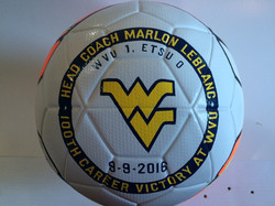 Painted soccer ball for coach props