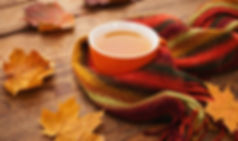 Autumn cup of tea and scarf