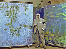 Claude-Monet-Standing-before-water-lily-
