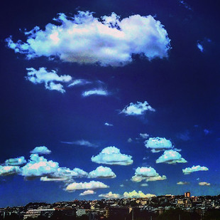the serial code of cloudiness in a cheeky blue sky (visions)